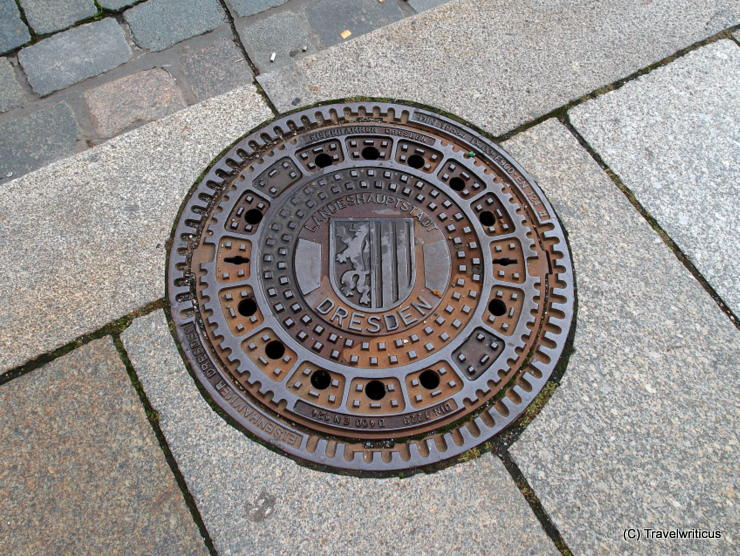 Manhole cover in Dresden showing the emblem of the city