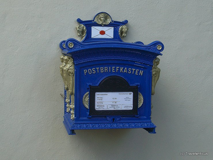 Blue postbox at a building in Frohnau