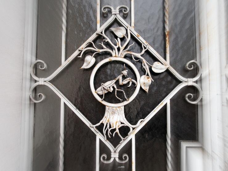 Praying mantis in the smithery of a door in Graz, Austria