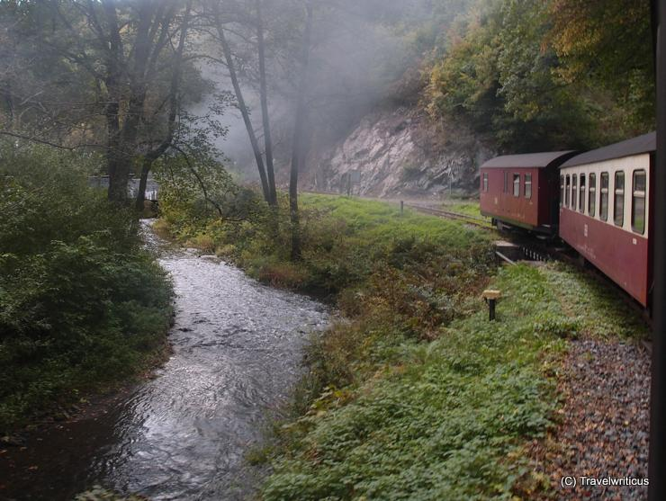 Passing the Selke River by the Selke Valley Railway in Harz, Germany