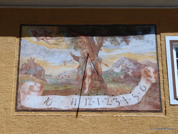 Sundial at the court of Millstatt Abbey showing Saint Sebastian
