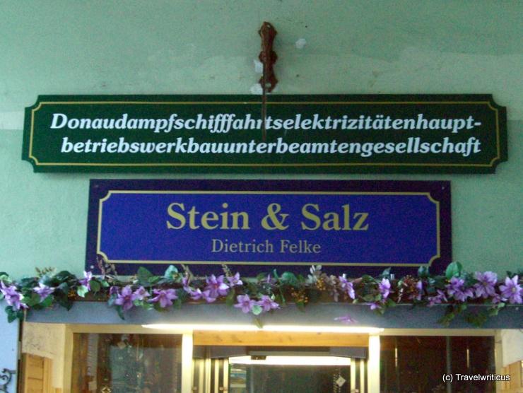 Sign 'Donaudampfschiffahrtselektrizitätenhauptbetriebswerkbauunterbeamtengesellschaft' in Passau, Germany