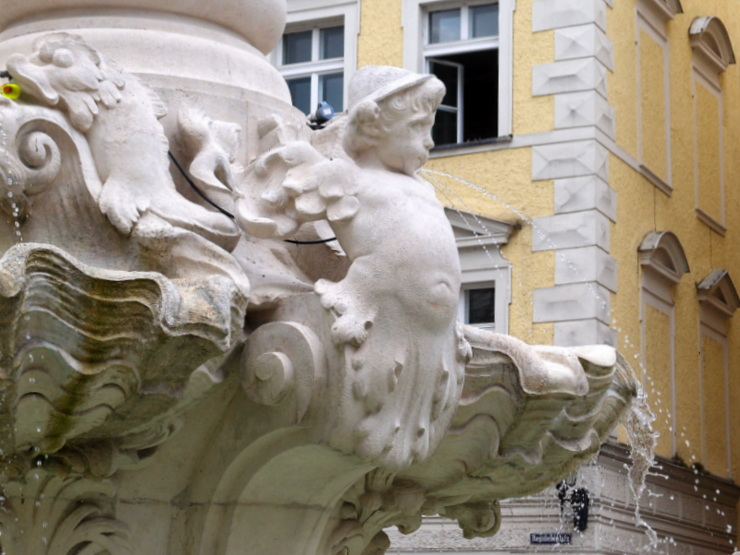 Angel wearing a Tyrolean hat at the Wittelsbach fountain in Passau, Germany
