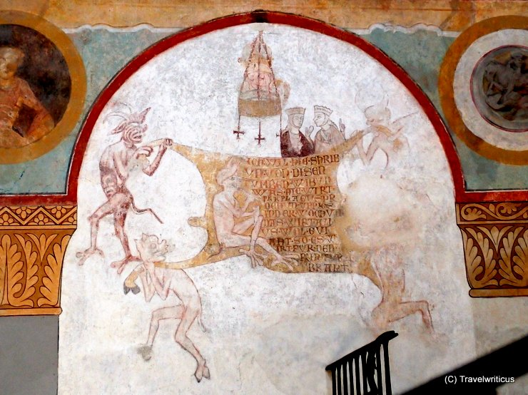 Fresco of devils and a cowhide at St George's Basilica