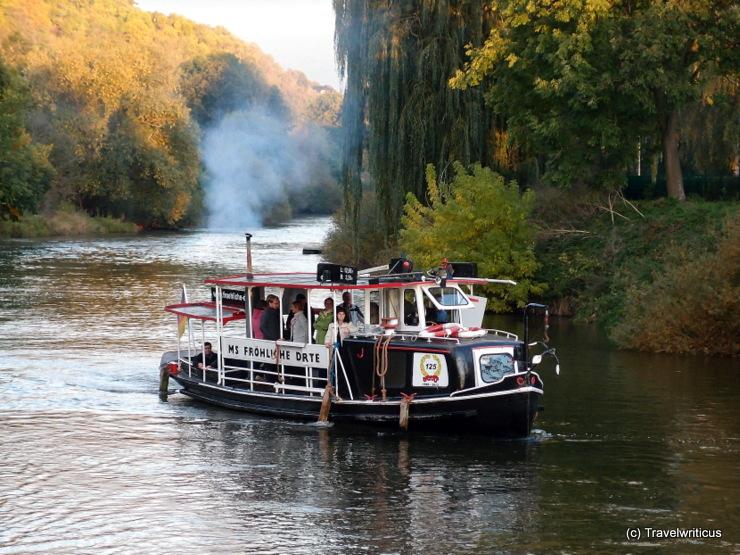 Cruise vessel 'Fröhliche Dörte' (1888) on the river Unstrut in Saxony-Anhalt, GermanyCruise vessel 'Fröhliche Dörte' (1888) on the river Unstrut in Saxony-Anhalt, Germany